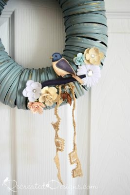 vintage lace and paper flowers hanging from a Summer diy wreath
