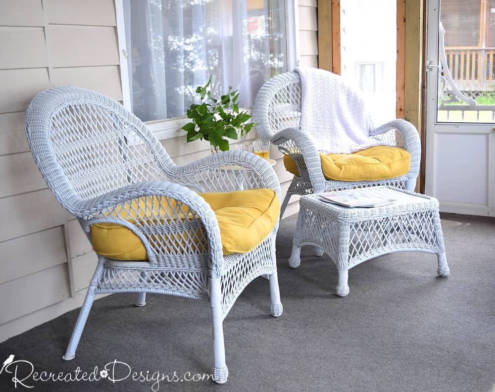 relaxing in oversized chairs on a cottage porch in the summer