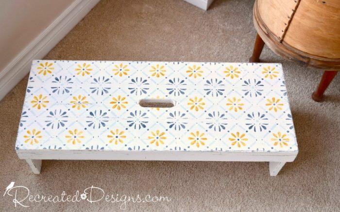 Dala Muses flower tile stencil on a vintage bench