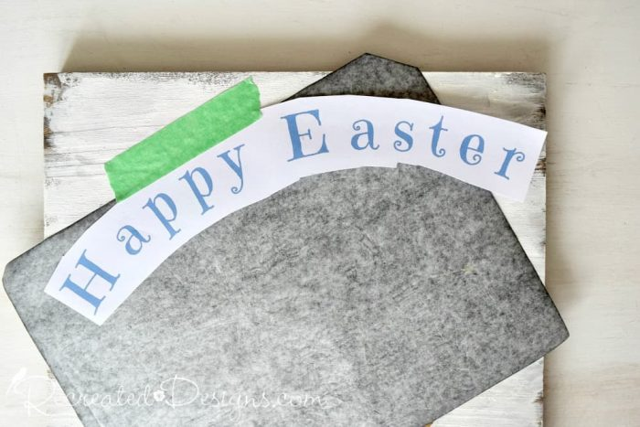 transferring Happy Easter to a rustic sign using graphite paper