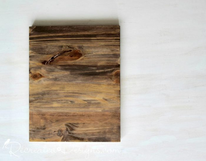 a piece of pine stained dark with Miss Mustard Seed's Milk Paint in Curio
