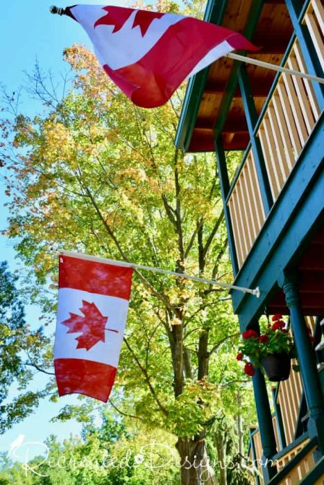 Canadian flags flying at The Opinicon, Elgin Ontario Canada
