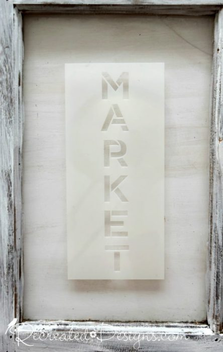 lining up a market stencil for painting