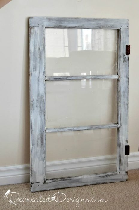 an old, vintage window painted white