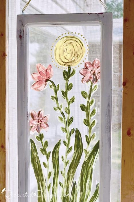 hand painted flowers on a reclaimed window