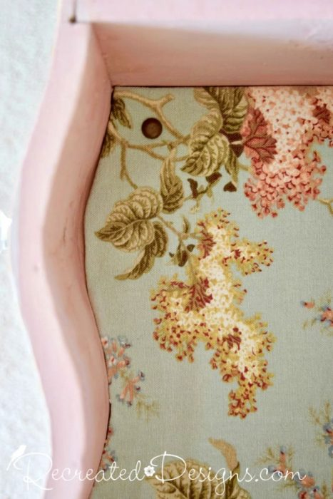 reclaimed fabric lining the drawers of a vintage dresser