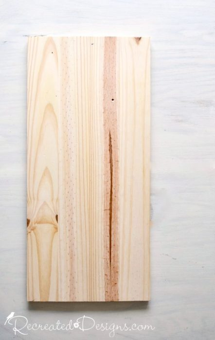 a plain piece of wood before a diy project