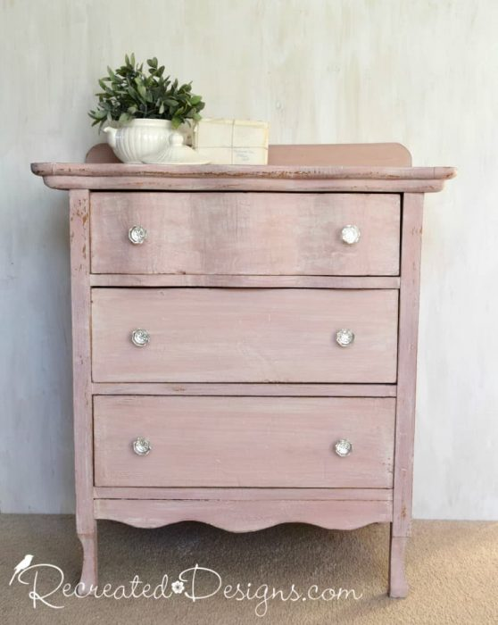 a vintage dresser painted with pink milk paint