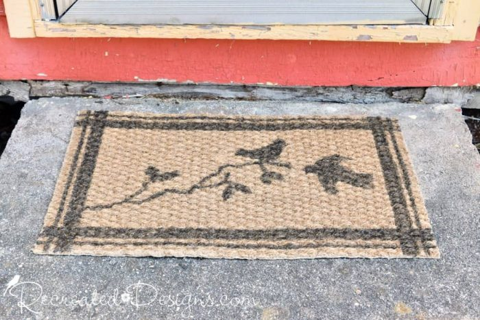 IKEA rug transformed with IOD stamps with stripes and birds