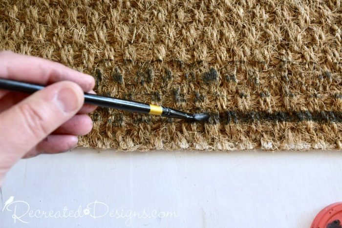 filling in stamps with IOD ink on a doormat