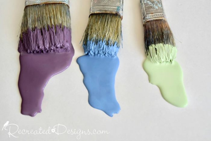 Madeline paint brushes with purple, blue and green paint