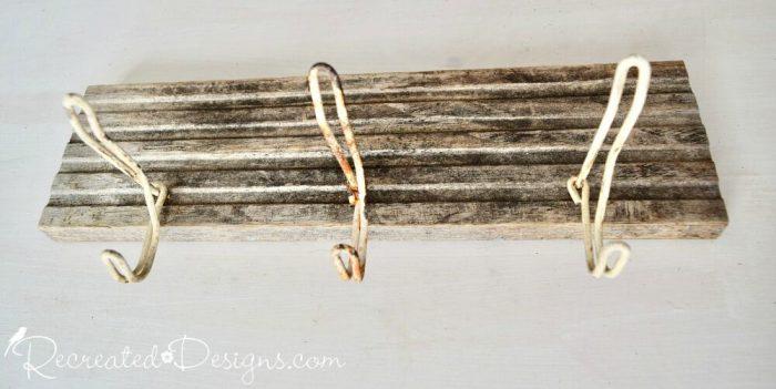 adding vintage hooks to reclaimed wood