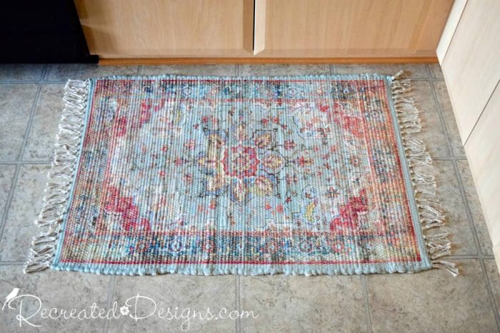 small rug with turquoise and burgundy pattern