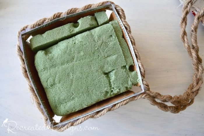 stuffing an old picking basket with floral foam