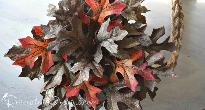 inserting leaves into floral foam to make a Fall wreath