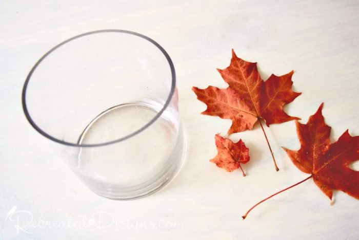 a thrifted glass candle holder and some Maple leaves