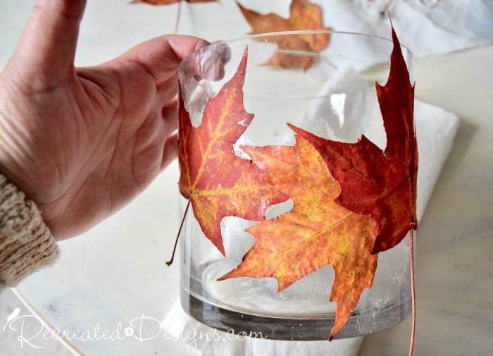 attaching Maple leaves to a glass jar with spray adhesive