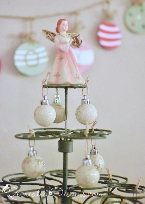 vintage angel on top of a Christmas tree