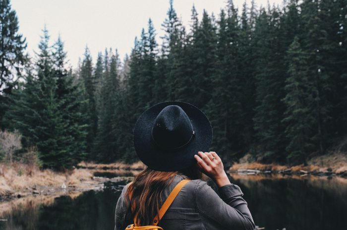 girl in forest on lake