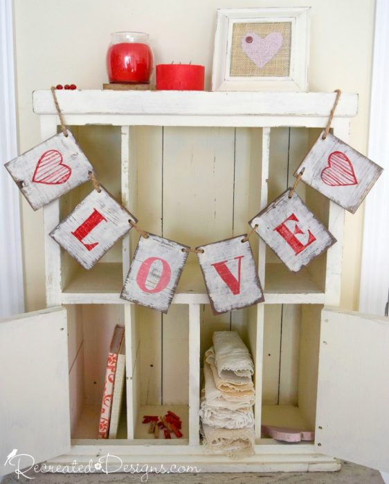 wooden love garland hanging on cabinet