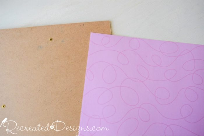 pink paper being adhered to shadowbox back