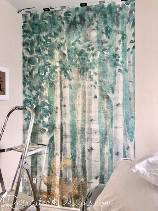 putting up wallpaper of a birch forest