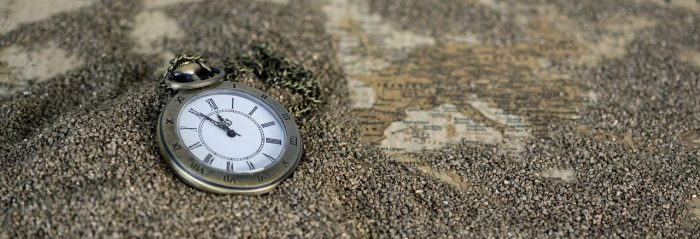 pocket watch and world map