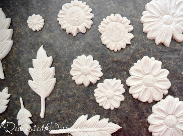 paper clay molds of flowers and leaves