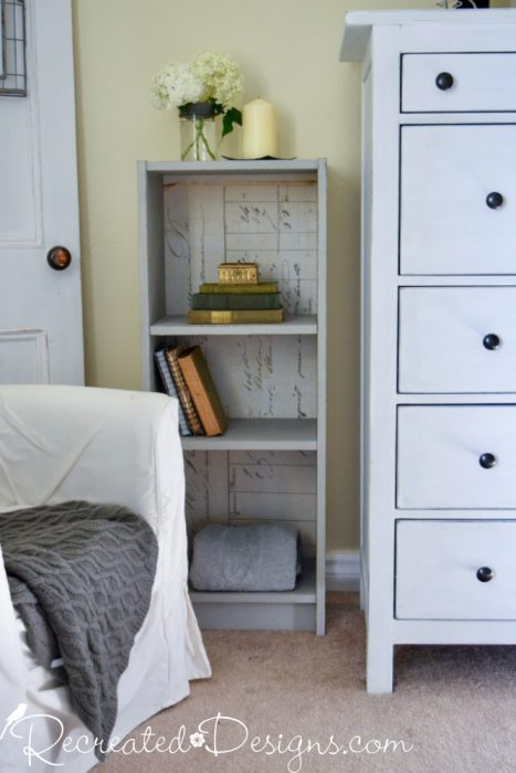 bookcase transformed with paint and paper