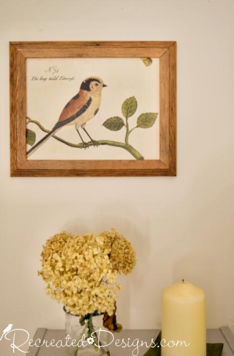 bird art in an old frame