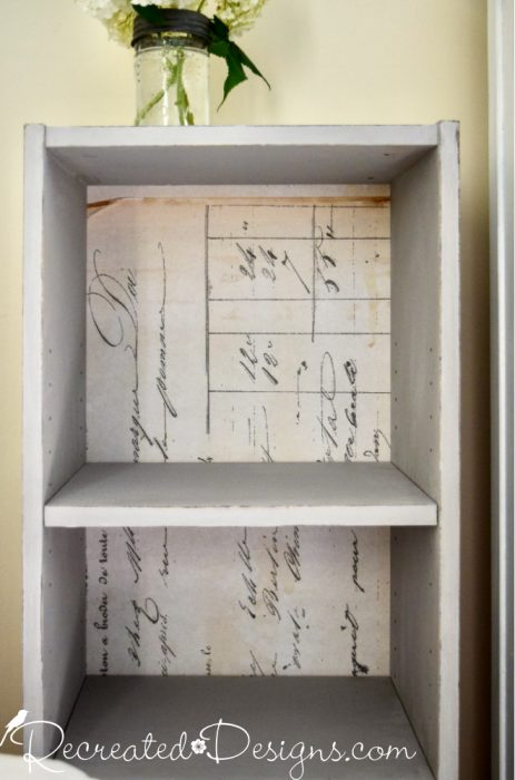 vintage-inspired paper at the back of a bookcase