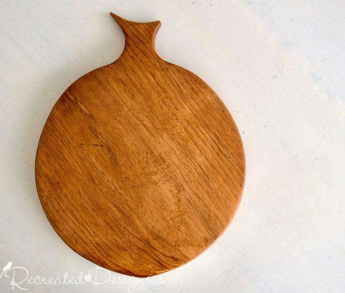 thrift store cutting board peach shaped