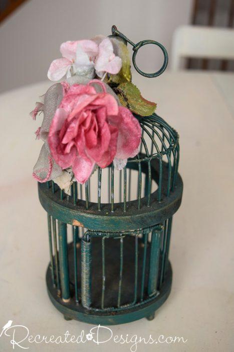 little green birdcage