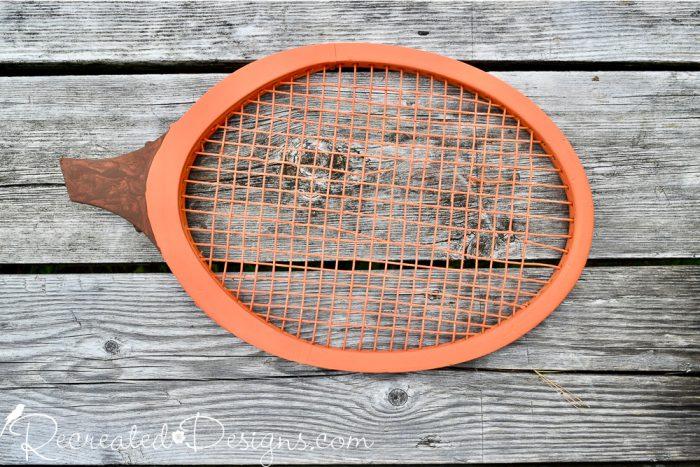 tennis racket painted orange