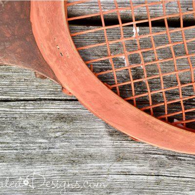 dark wax over orange paint on a tennis racket