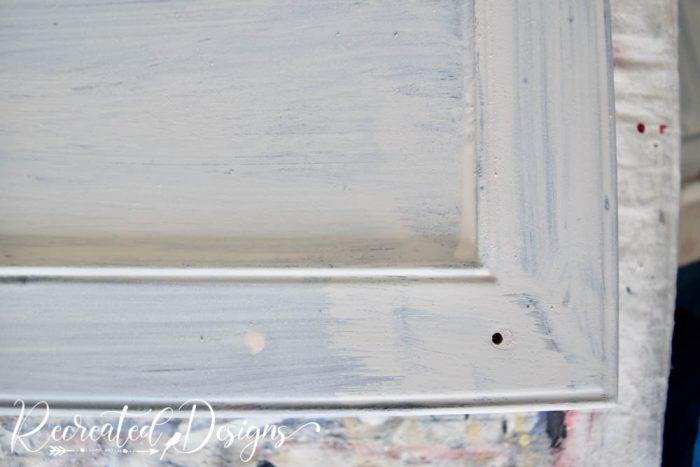 First Coat of Milk Paint on cabinet doors
