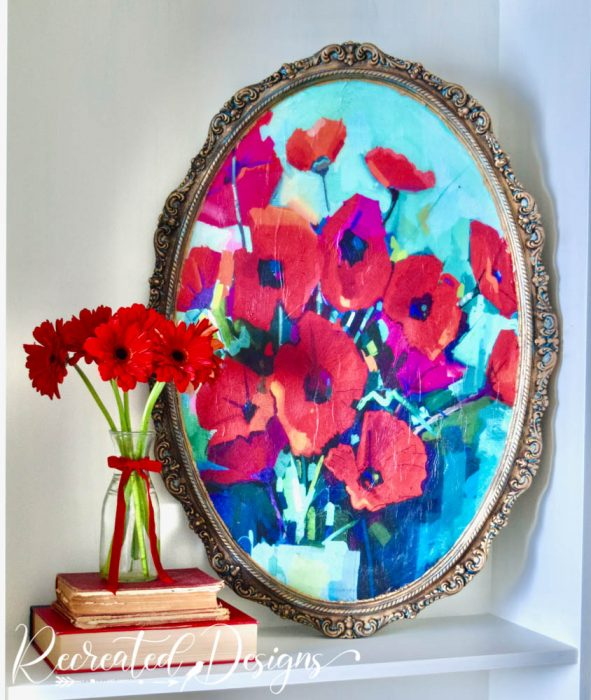 a vintage mirror turned into art