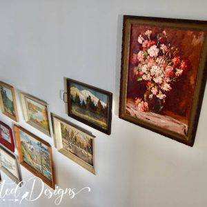 collection or vintage art in a stairwell