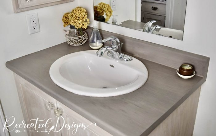 bathroom counter and cabinet painted with milk paint