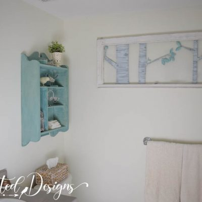 bathroom done in creams and teal
