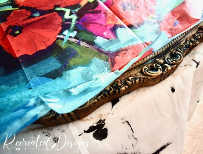 laying Mint decoupage paper onto a vintage mirror