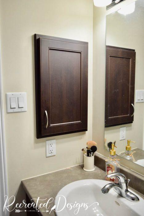 bathroom medicine cabinet before makeover