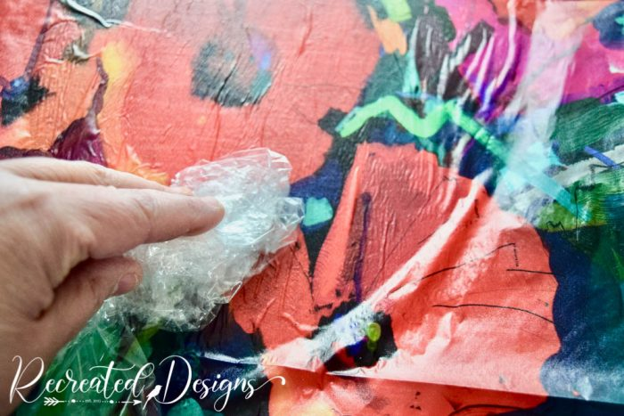 smoothing out Mint decoupage paper
