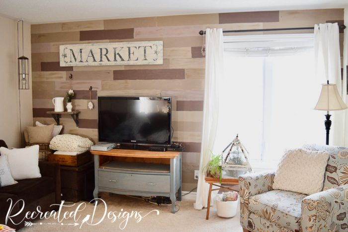 living room wall painted faux wood