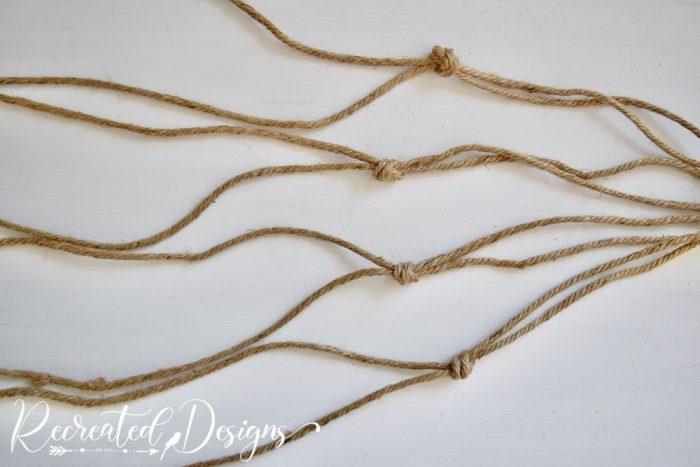 tying knots in jute twine