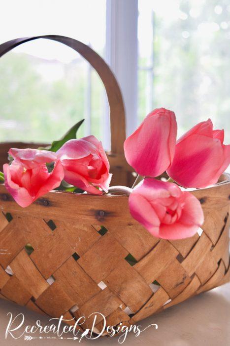 pink tulips in a vintage basket