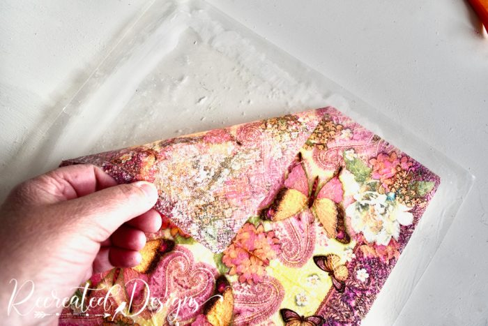 peeling up a napkin covered in dried mod podge
