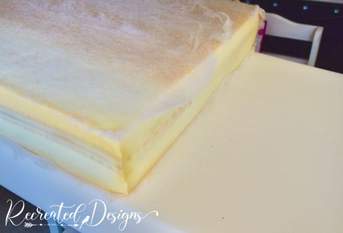 measuring new foam to cut