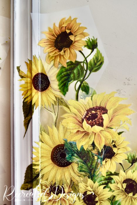 applying sunflower transfers to glass and frame