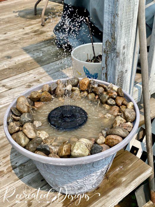 solar fountain in a flower pot